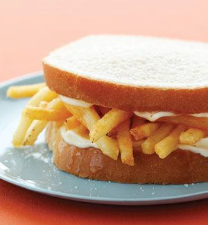 "Chip Butty sandwich - bread, butter, and fries. Butty is a Welsh term for ""sandwich"" and slang for ""friend"" or ""buddy."" It's not surprising that this is one of the most beloved sandwiches in the United Kingdom, especially in the north. After a long night out on the town, a Chip Butty might just be your best friend, too."