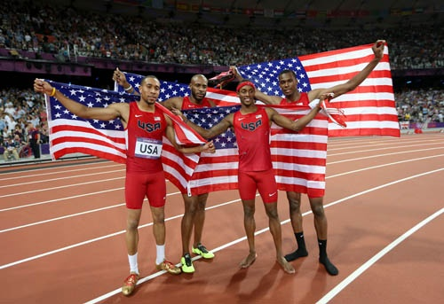 United States Silver Medalists:  Bryshon Nellum, Joshua Mance, Tony McQuay & Angelo Taylor celebrate their Silver Medal run after the Men's 4 x 400m Relay Final on Day 14 of the London 2012 Olympic Games at Olympic Stadium on August 10, 2012 in London, England.