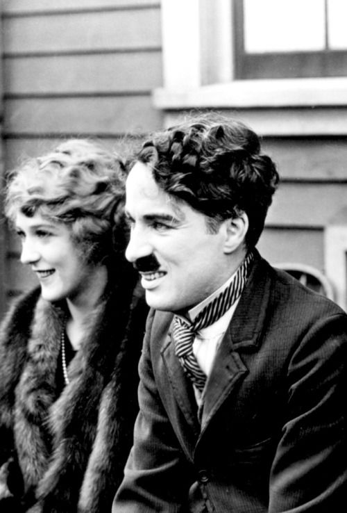 Mary Pickford & Charlie Chaplin photographed at the announcement of the formation of the United Artists corporation,1919