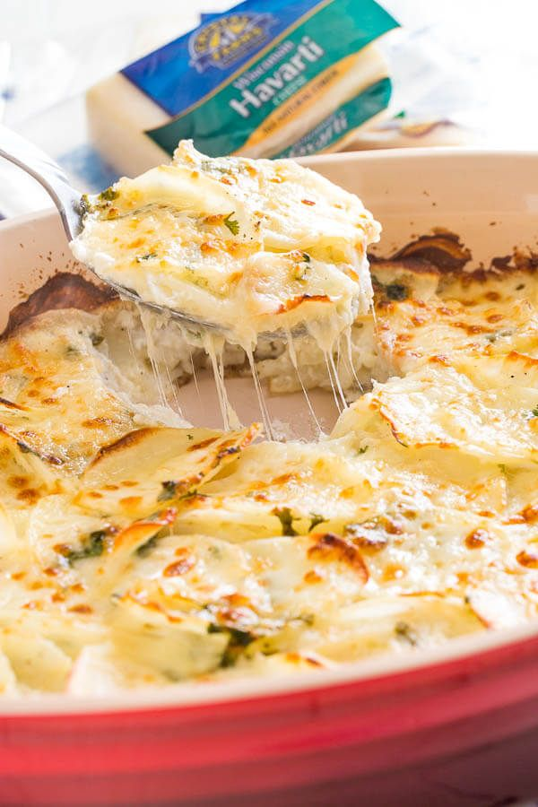 This family favorite cheesy scalloped potatoes are famous for its creamy richness and delicate cheesy layers. Excellent make-ahead side dish for a crowd! #CrystalFarmsCheese #CheeseLove #ad