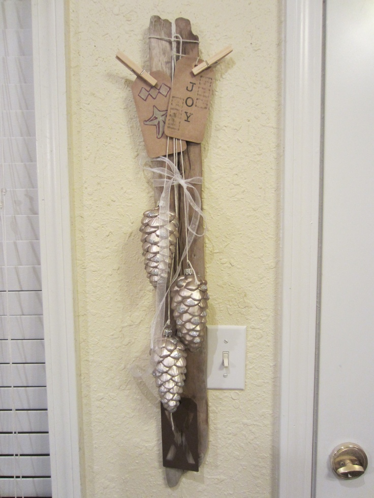 Xmas decorations on driftwood.