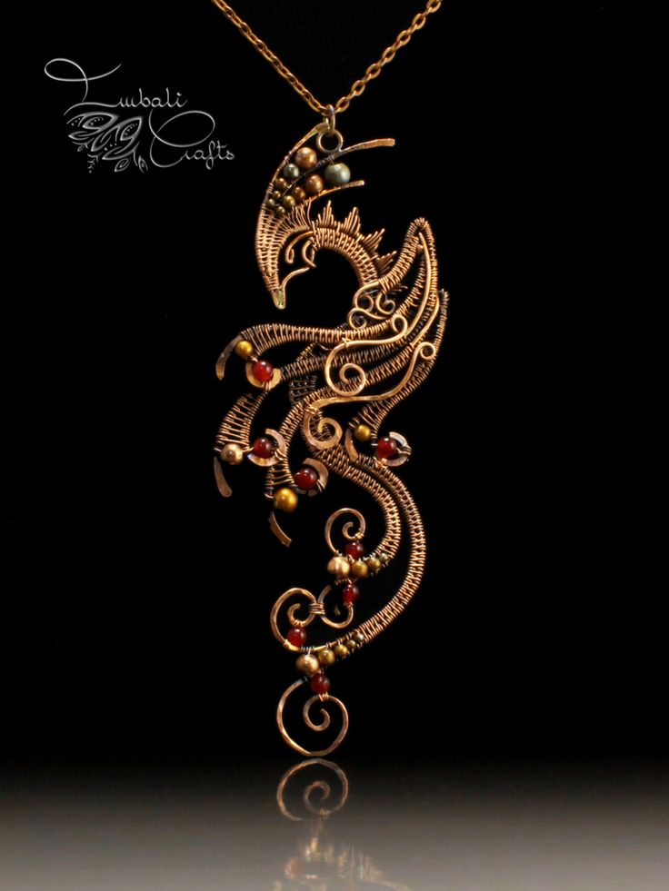 Wire weave copper phoenix necklace with red garnet garnet by Nadja Shields from Imbali Crafts