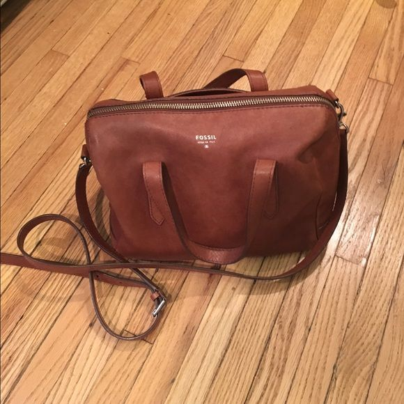 Fossil Sydney Satchel Brown Fossil Sydney Satchel Brown. Previously loved. Genuine smooth leather, back slide zipper, detachable and adjustable strap. Purse has inside pockets and an outside pocket to hold your phone. Some wear on the bottom and a pen mark as pictured. Make me an offer. Fossil Bags Satchels