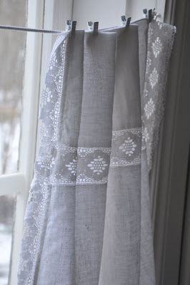 a romantic repurposing of an old linen and lace tablecloth for a simple window treatment.