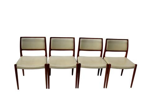 Niels O. Møller - A set of four teak dining chairs upholstered with beige leather