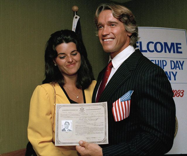In this September 16, 1983 file photo, actor and bodybuilder Arnold Schwarzenegger shows off his new U.S. citizenship papers as Maria Shriver, daughter of Sargent and Eunice Shriver, looks on at the Shrine Auditorium in Hollywood, Calif. (Photo by Wally Fong/AP Photo) Details