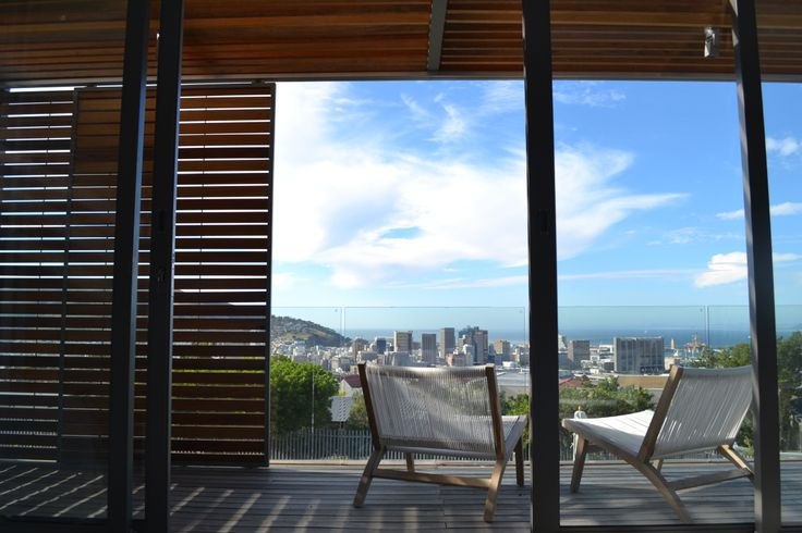 timber shutters and decking with minimalist glass balustrade neutral colour and texture  shirley wayne architect @ www.swarchitect.co.za
