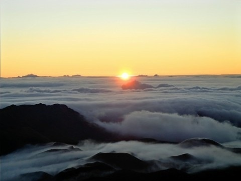 Watching the sunrise, 10,000 ft above sea level, Mount Haleakala above the clouds in Maui. One of the most amazing things I'll ever experience.