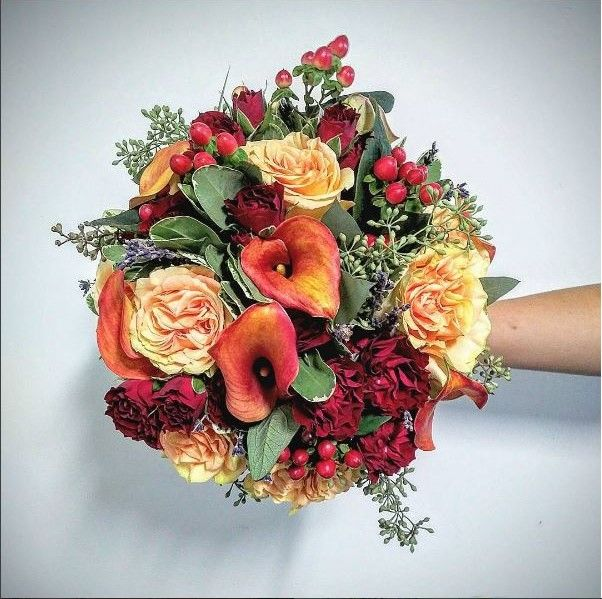 Gorgeous Fall Wedding bridal Bouquet  created by Peony House Floral Studio. Calla lily, finesse rose, hypericum berries, seeded eucalyptus, lavender, royal red spray roses...