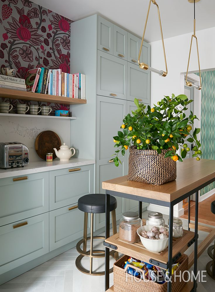 In this galley kitchen renovation, colorful cabinets, brass hardware and bold wallpaper refreshed the dated space. | Design: Sarah Hartill Photo: Alex Lukey