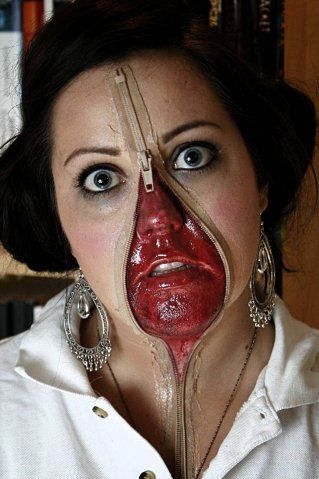 Wow!!!! reepy Halloween face...actually easy to do....just attach a zipper using some eyelash glue to your face, open zipper in middle of face and using red halloween face paint color in any part of your skin that is in the middle of the opening.