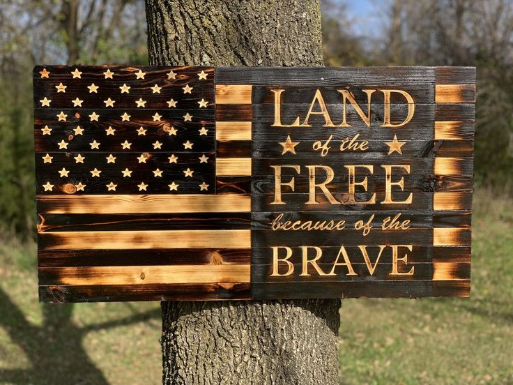 Land of the free because of the brave rustic wooden flag