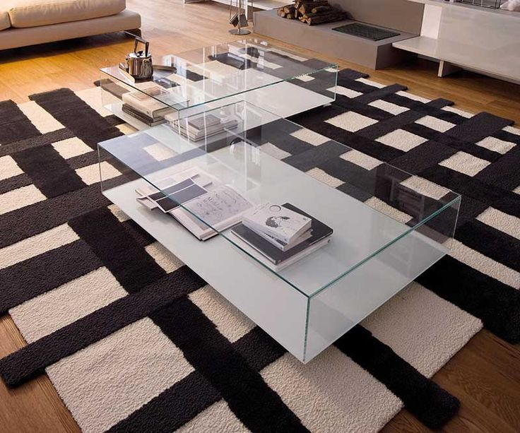The Miss glass coffee table is a two piece set of contemporary design which complements any modern living room. See it here.