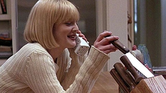 "20 years ago today ""Scream"", directed by Wes Craven and starring Drew Barrymore, hit theaters around the USA. Originally titled ""Scary Movie"", the script was written by Kevin Williamson. It was his first screenplay after taking several stabs at acting. Williamson would go on to create the TV series ""Dawson's Creek"" and ""The Following"". Meanwhile ""Scream"" would spawn three sequels, a TV series, and countless Halloween masks."