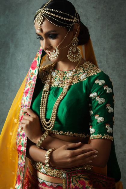 Indian Blouses - Green Blouse with White Pearl Embroidery on Sleeves, Pearl and Gold Jewelry, Yellow Dupatta | WedMeGood #indianwedding #indianbride #blouse #choli #green #pearl #wedmegood