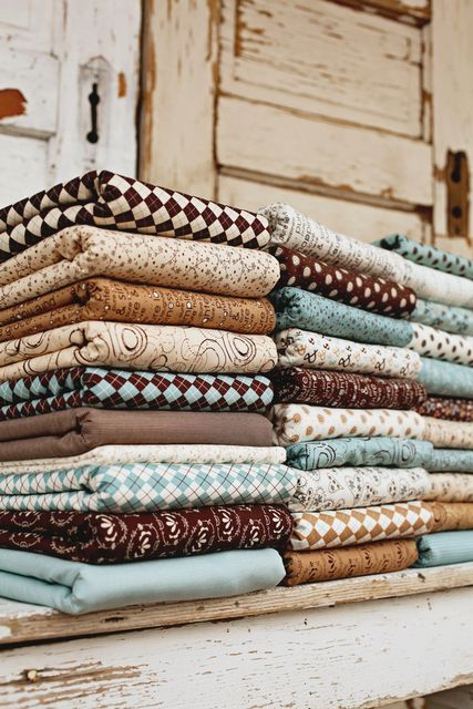 Stacks of fun fabrics in shades of blue and brown