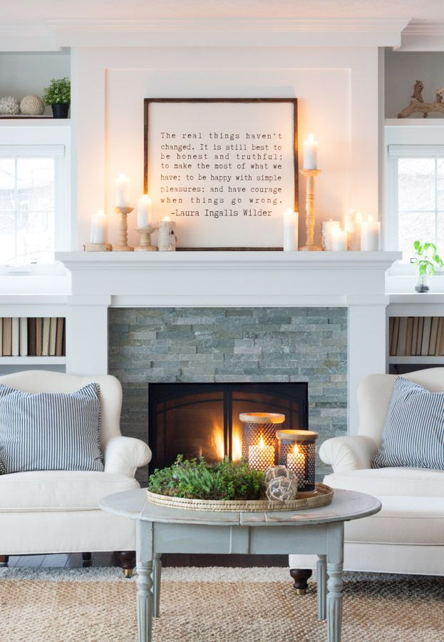Large quote framed on fireplace mantle with candles