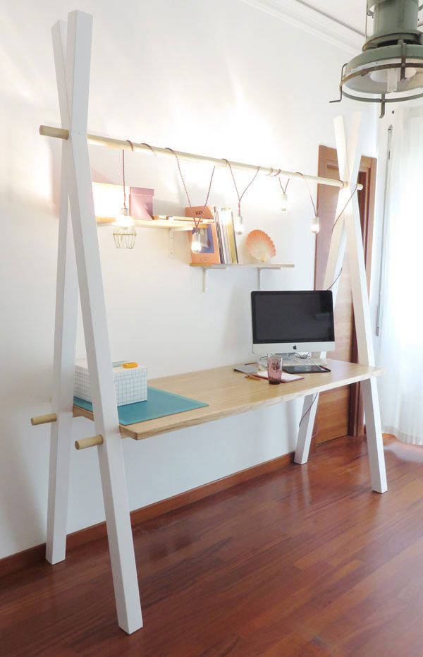 This simple modern desk by Tommaso Guerra is super functional and practical, it has crisscross legs and a holder