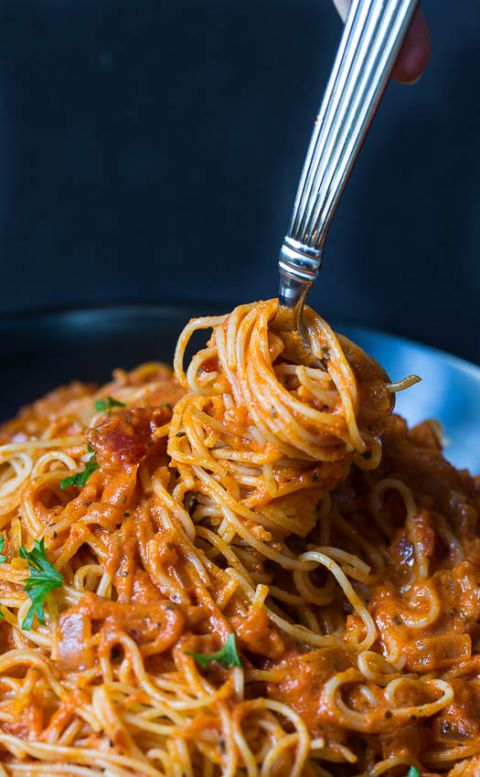 Spicy Tomato Cream Spaghetti- Spice was everything you didn't know your spaghetti needed. Get more spaghetti and pasta dinner recipes this holiday season at redbookmag.com.