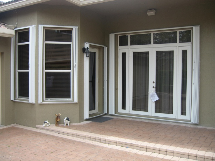 STRONG PROTECTION OFFERED BY PROPERTY SHUTTERS....  Impact windows and doors,increases resale value of your home and Helps in reducing outside noise.  @ http://propertyshutters.com/impact_windows