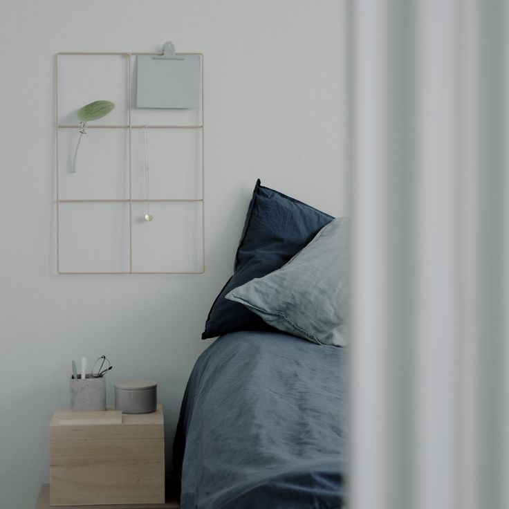 Blue bedroom with turquoise linen sheets in Stockholm, Sweden. Grid by wallment design, made in Finland.