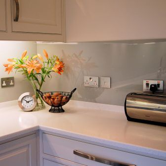 Photograph Showing Glass back Splash Cut-outs for Electrical Sockets