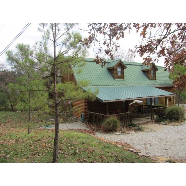 Log cabin w green metal roof cabin o 39 dreams for Log cabin portici e ponti