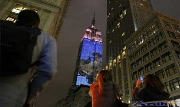 Fashion icons light up NY's Empire Building
