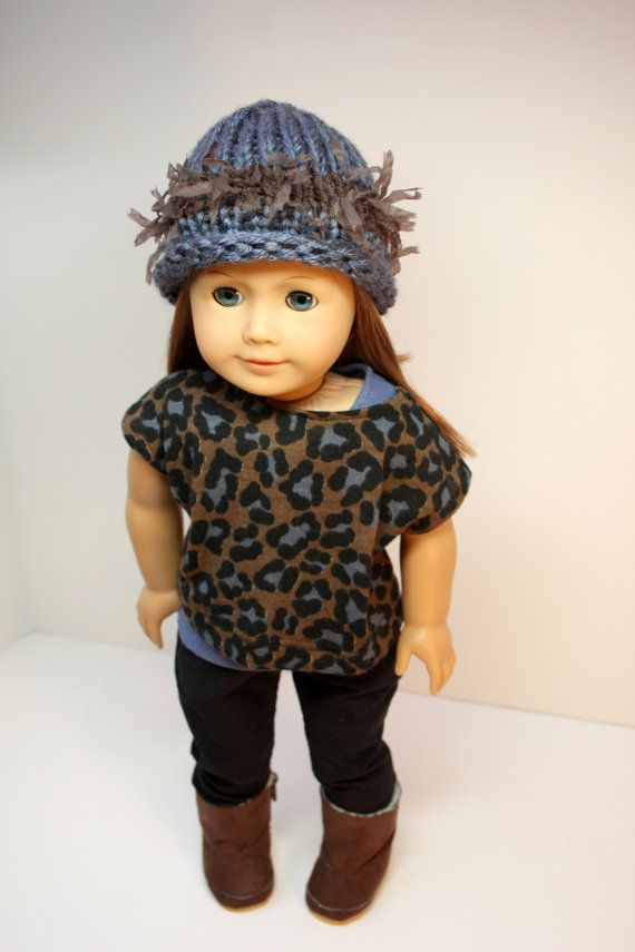 This is a complete 5 piece outfit for your trendsetting girl!    The black corduroy skinny jeans are top stitched and have real working pockets and an elastic waist. The blue cotton knit tee is sleeveless and has velcro in the back. The off-the-shoulder tank is an animal print cotton knit with velcro in the back. The rolled brim hat is blue and brown to perfectly match the tank and is hand knit for a great addition to the outfit. The brown suede boots have fur lining and are included.  Using…
