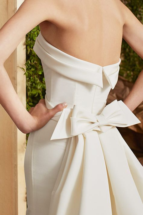 a2d2dab9d559 Arielle wedding dress from the Carolina Herrera Bridal Spring 2017  Collection - Strapless wedding dress with bow detail - see the rest of the  collection on ...