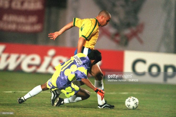 Ronaldo of Brazil, taking the ball past the Mexican goalkeeper, Jorge Campos