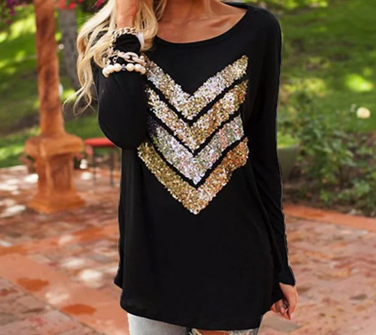Long sleeve black shirt with glitter arrows on the front. - Hassle-free 7 day return policy - Free shipping on all US orders - Safe and Secure Checkout