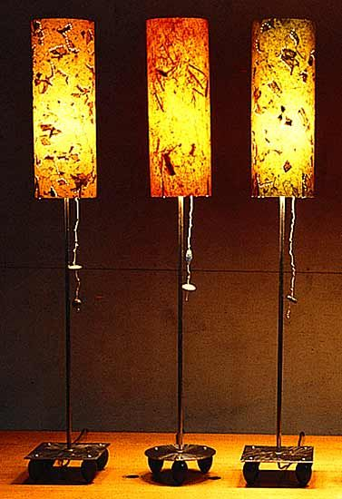 Jumbo Lamps by Clark Ellefson. Lamp fabricated from steel and Asian paper shades. Twisting pull switches. Stems and bases have a bright steel finish; bases also have a brushed finish. Uses a 100-watt incandescent bulb (included). Available in three colors and two base shapes.