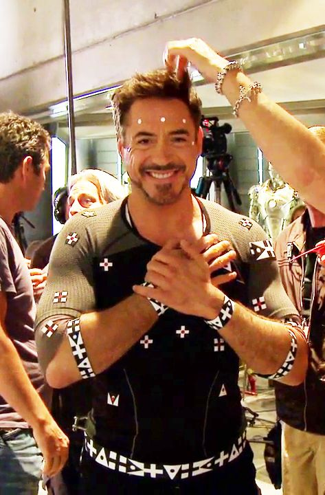 "Robert Downey Jr. getting motion-capture dots applied for the opening workshop scene in ""Iron Man 3"""