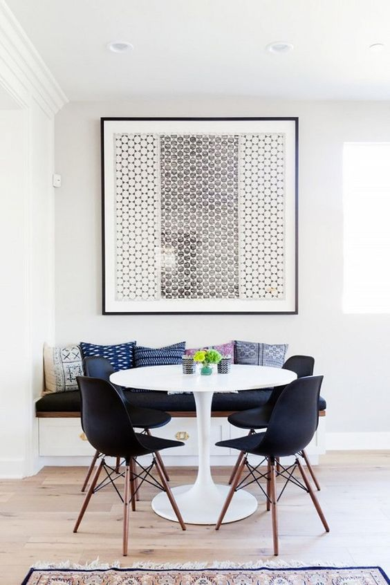 Like most modern apartments, this too is painted white, but also has a burst of colors https://www.barcelona-designs.com/products/tulip-table-replica-oval-shaped-dining-table?utm_content=buffer91126