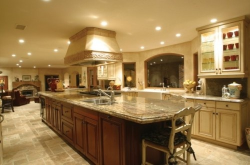 Open floor plan to living & dining rooms. Vent hood is beautiful too.