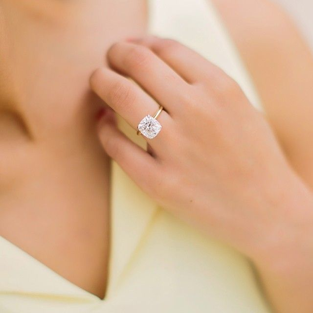 I'm starting to like the solitare cushion cut paired with a diamond wedding band.