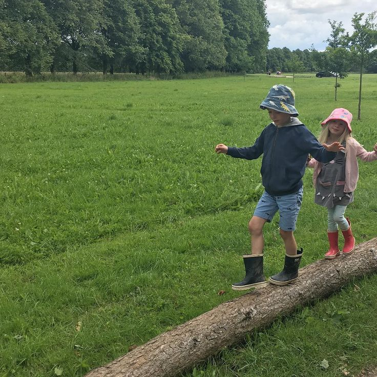 Kids in bright rain boots...walking on a wire!  Photo from @ themummydiary Instagram