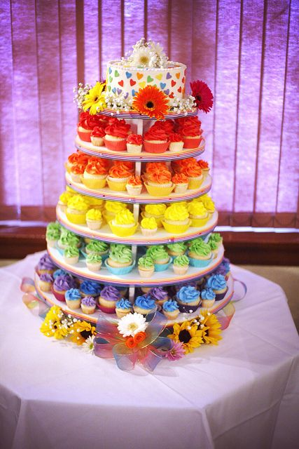 Very cute blend of cake and cupcake, in rainbow of course. From a Offbeat wedding @ offbeatbride.com