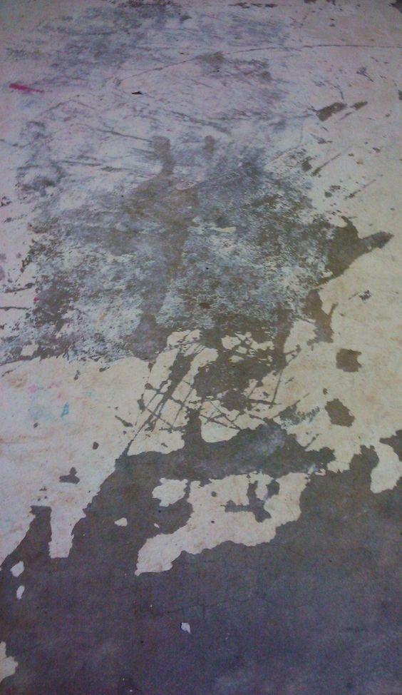 Preparing already painted cement floor for repainting.