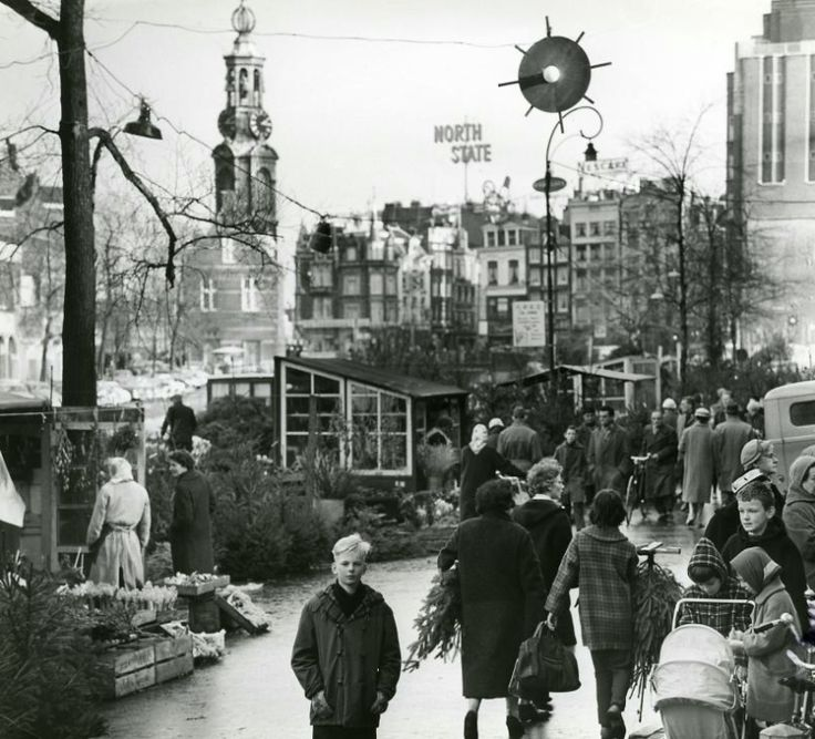 Christmas market at the Bloemenmarkt (Flower market) with Munt tower in the background, 1965:   KUPU HOME // ku-pu.com