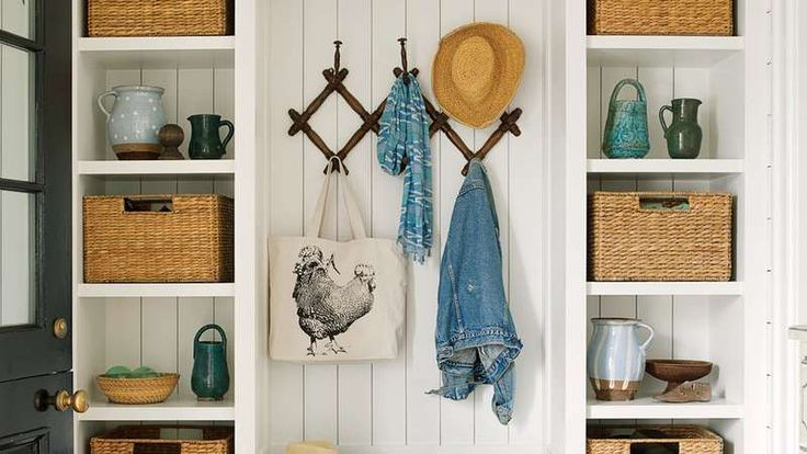 """A Dutch door on the side of the house opens to a smartly designed mudroom with plenty of spots for stashing gear. """"I always like to have hooks of some kind, and all the better if they are cute,"""" says Howard, who installed a Victorian coat rack for a catch"""