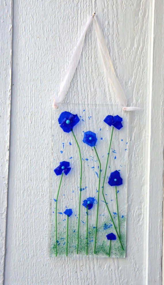 "Blue Flax Flower SunCatcher Blue Fused Glass by TEN36Designs  Measuring approximately 8""x4"" with soft rounded edges & slightly raised sections make this a unique one of a kind SunCatcher for your garden paradise. Every year a new style or series of sun catchers are designed; each one is dated and signed for authenticity! $20.00"