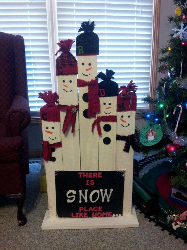 Snowman family made from old christmas sweaters, fence post, and random craft items i found around the house. Feeling creative!