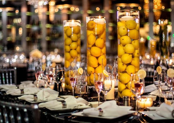 Table Setting Used With Yellow Lemons Flowers Floating In Water Inside Simple Tall Vases The Wedding Studio Schaumburg IL