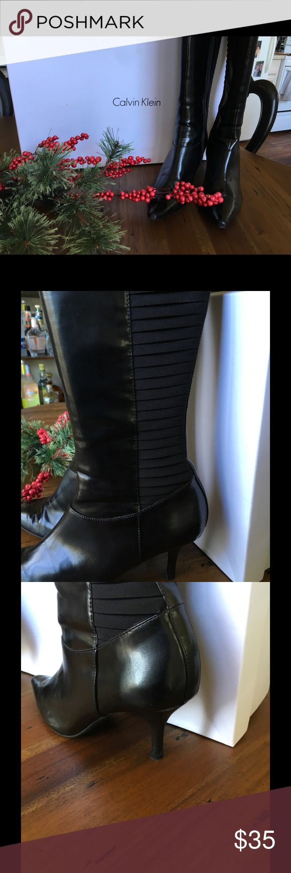 Calvin Klein Robin Stretch Boot Good condition black stretch boots with normal wear.  Man made synthetic materials. RePosh, too big. They could use a good polishing😉 Calvin Klein Shoes Heeled Boots