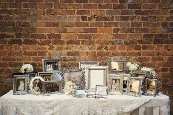 Put together a mismatched collection of frames to hold old photos for a wedding table. | 23 Totally Brilliant DIYs Made From Common Thrift Store Finds