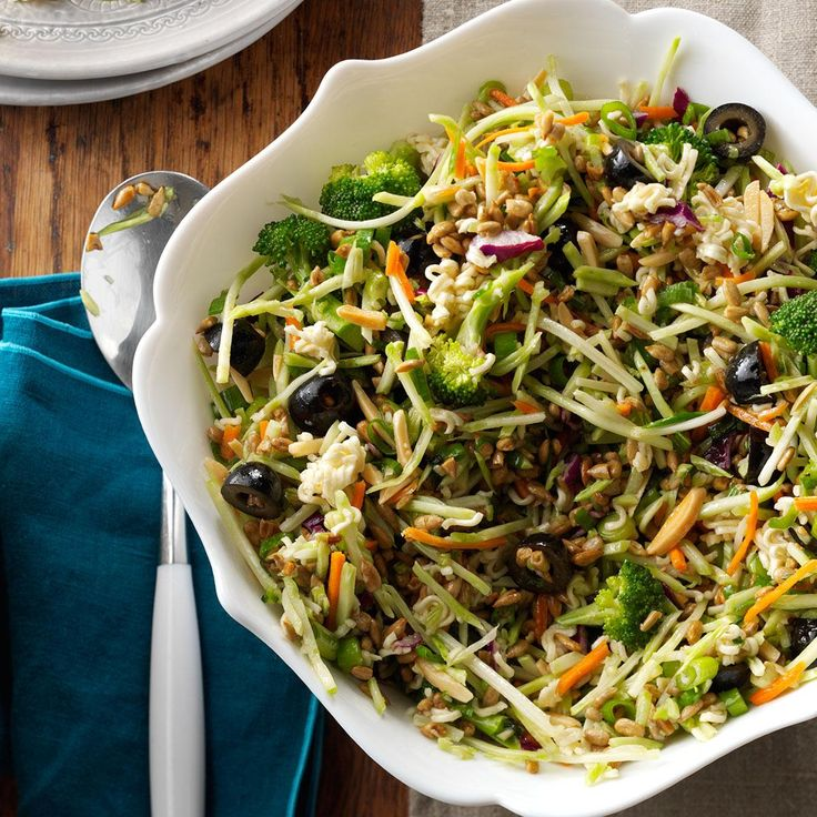 Nutty Broccoli Slaw Recipe from Taste of Home   The sweet dressing nicely coats a crisp blend of broccoli slaw mix, carrots, onions, almonds and sunflower kernels. Crushed ramen noodles provide even more crunch.
