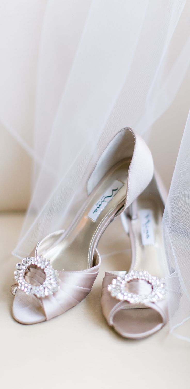 A crystal adorned low heel in champagne crystal satin by Nina Shoes. Photo by http://maryneumannphotography.format.com Shoes by http://ninashoes.com/crystah-champagne-crystal-satin--18803