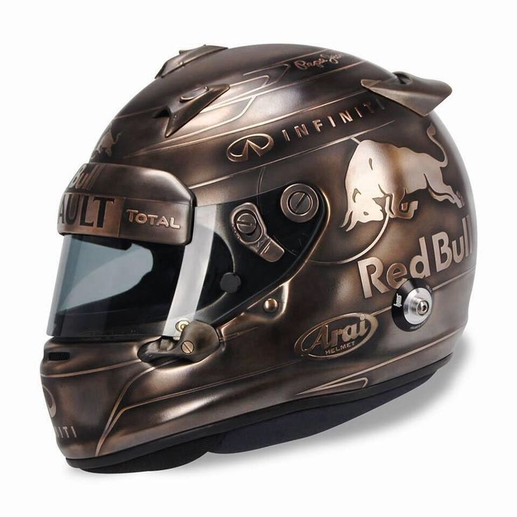 Not McLaren, but Vettel has one of the coolest helmet designs of all time here.